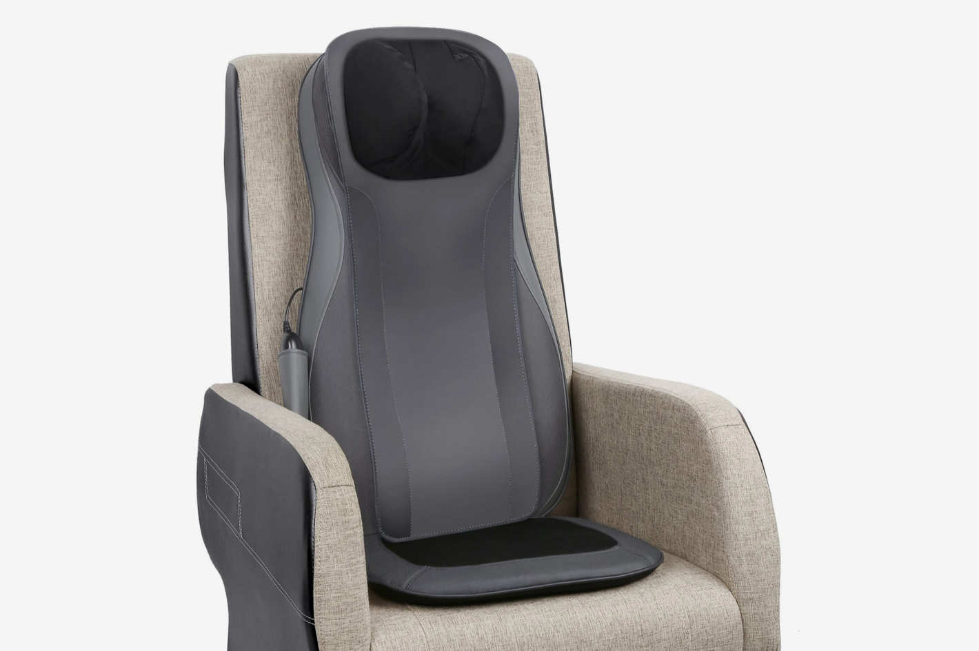 A gray massage cushion attached to a gray chair with brown upholstery.