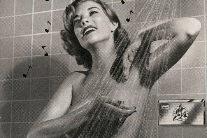 Retro woman showering, for The Strategist's review of a Thai all-natural deodorant spray.