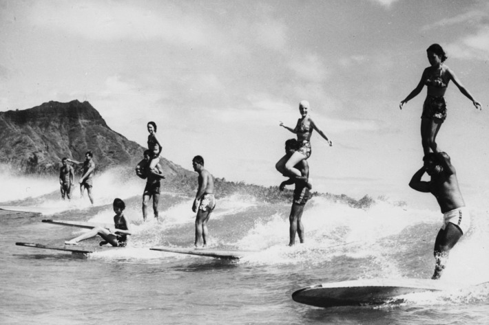 Surfers in Hawaii, for a post on the best wetsuits and rash guards according to surf instructors — The Strategist