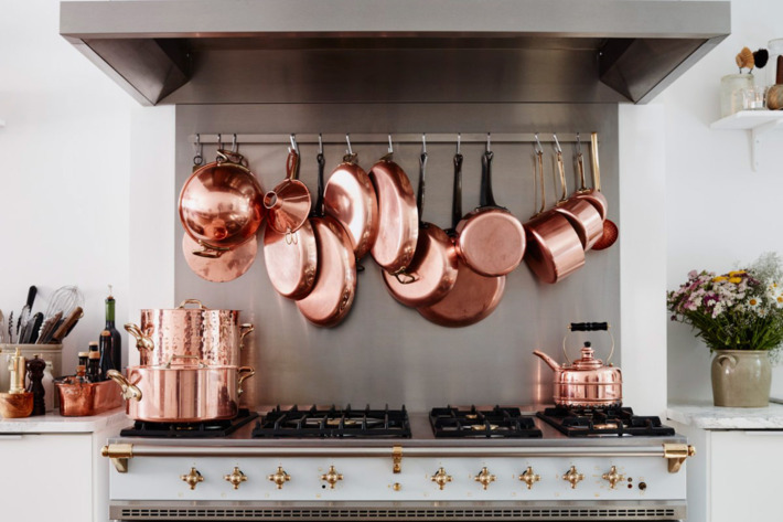 Copper pots hanging in the French kitchen of the Cook's Atelier in Paris — the Strategist reviews all the essentials needed to re-create a French kitchen.
