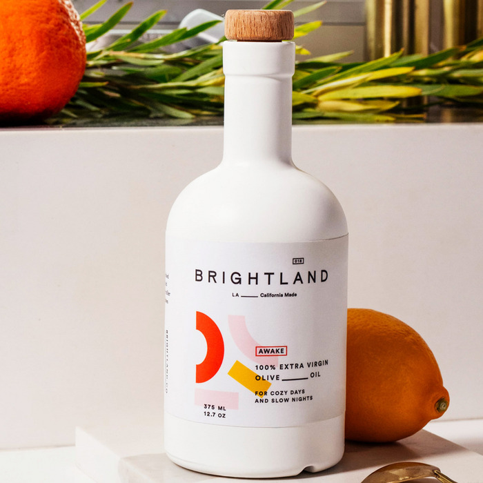 white bottle of brightland extra virgin olive oil - strategist best olive oils