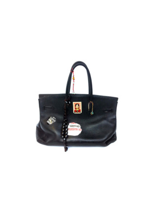 f50cbec6ae The Birkin bag s namesake Jane Birkin is auctioning off one of her Birkin  bags on eBay tomorrow to raise money for the Red Cross s relief efforts in  Japan.