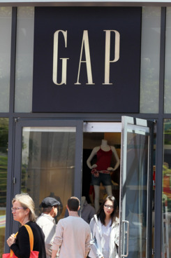 SAN FRANCISCO, CA - MAY 19: Pedestrians walk by a Gap store on May 19, 2011 in San Francisco, California. Clothing retailer Gap Inc. will announce first quarter earnings today after the stock market close. (Photo by Justin Sullivan/Getty Images)