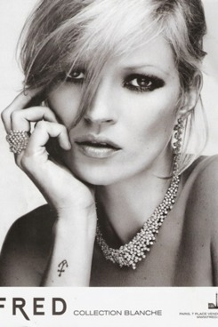 Kate Moss models her new jewelry.