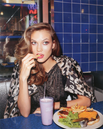 Karlie Kloss, apparently not really enjoying her fry.