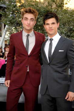Robert Pattinson & Taylor Lautner. Robert is quite possibly crying inside a little.