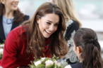 Kate winning over a potential voter with flowers.