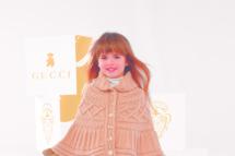 A fabulous Gucci-wearing child.