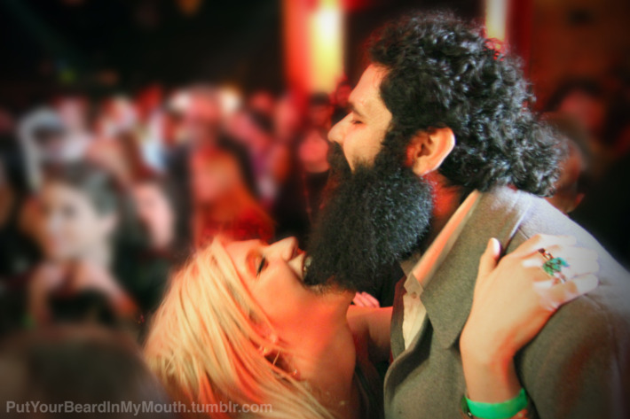 Yes, this is Ke$ha chewing on some poor man's bushy beard.