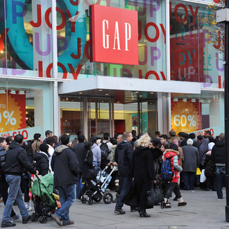 LONDON, UNITED KINGDOM - DECEMBER 26: Eager shoppers descend on stores on Oxford Street for the Boxing Day sales on December 26, 2011 in London, England. Dubbed