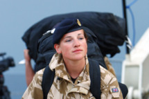 A British troop disembarks from the Royal Navy amphibious assault ship HMS Albion on April 21, 2010 on her arrival in Portsmouth, on the south coast of Britain after British troops returned home from Afghanistan and British holidaymakers repatriated after being stranded on holiday. Passengers were picked up in Santander, northern Spain, on April 20, and ferried to Portsmouth after aeroplanes across Europe were grounded by the volcanic ash cloud spreading in the upper atmosphere from Iceland.