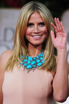 Heidi Klum, busy waving at her dinner.