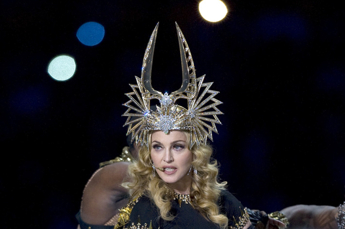 Madonna performs at the 2011 Super Bowl Halftime show.