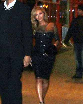 A not-so-good photo of Beyonce looking fabulous, and apparently walking behind a sailor.