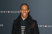 New York Giants wide receiver Victor Cruz poses backstage at the Tommy Hilfiger Presents Fall 2012 Men's Collection show during Mercedes-Benz Fashion Week at Park Avenue Armory on February 10, 2012 in New York City.
