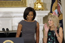 First lady Michelle Obama is applauded by Dr. Jill Biden after speaking before the National Governors Association, Monday, Feb. 27, 2012,  in the State Dining Room of the White House in Washington.