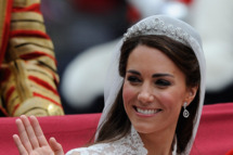 Catherine, Duchess of Cambridge waves as she travels beside husband Prince William, Duke of Cambridge in the 1902 State Landau carriage on the procession route along The Mall to Buckingham Palace after their wedding ceremony at Westminster Abbey on April 29, 2011 in London, England. The marriage of the second in line to the British throne was led by the Archbishop of Canterbury and was attended by 1900 guests, including foreign Royal family members and heads of state. Thousands of well-wishers from around the world have also flocked to London to witness the spectacle and pageantry of the Royal Wedding.