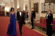 US President Barack Obama and first lady Michelle Obama walk through the Cross Hall to the East Room of the White House on February 29, 2012 in Washington. Obama and his wife Michelle hosted a dinner for members of the US armed forces who served in Iraq and Afghanistan.     AFP PHOTO/Brendan SMIALOWSKI (Photo credit should read BRENDAN SMIALOWSKI/AFP/Getty Images)