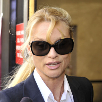 Nicollette Sheridan arrives in court