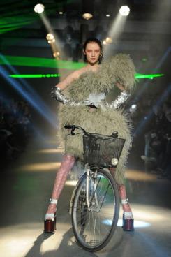 Dempsey Stewart biking through the Vivienne Westwood show.