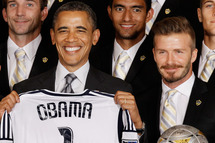 "WASHINGTON, DC - MAY 15:  U.S. President Barack Obama (L) poses for photographs with the Major League Soccer champions Los Angeles Galaxy and their mid-fielder David Beckham in the East Room of the White House May 15, 2012 in Washington, DC. Players from the Galaxy also participated in a ""Let's Move!"" question and answer session with school-age sports fans and first lady Michelle Obama after the ceremony.  (Photo by Chip Somodevilla/Getty Images)"