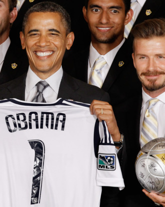 WASHINGTON, DC - MAY 15: U.S. President Barack Obama (L) poses for photographs with the Major League Soccer champions Los Angeles Galaxy and their mid-fielder David Beckham in the East Room of the White House May 15, 2012 in Washington, DC. Players from the Galaxy also participated in a
