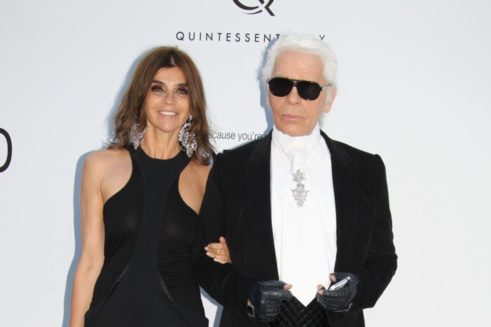 ANTIBES, FRANCE - MAY 24: Carine Roitfeld and Karl Lagerfeld attend the 2012 amfAR's Cinema Against AIDS during the 65th Annual Cannes Film Festiva at Hotel Du Cap on May 24, 2012 in Antibes, France. (Photo by Eric Ryan/Getty Images)
