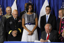 First lady Michelle Obama joined Illinois Gov. Pat Quinn, as he signed the Military Family Licensing Act into law Tuesday, June 26, 2012, at the Illinois National Guard Armory in the South Loop in Chicago, Illinois.