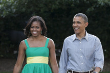 U.S. President Barack Obama and first lady Michelle Obama walk to the South Lawn of the White House on June 27, 2012 in Washington, D.D. The annual picnic was held for members of Congress.