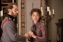 Jude Law (L) stars as Alexei Karenin and Keira Knightley (R) stars as Anna in Joe Wright's ANNA KARENINA, a Focus Features release.