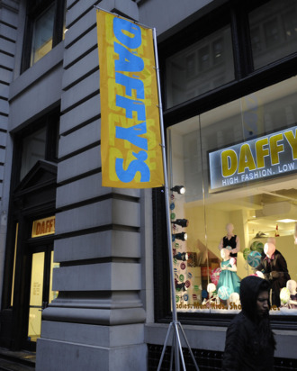 Shoppers walk past Daffy's, a fashion brand name discount chain store, in New York, December 11, 2008.