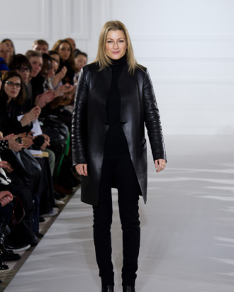Designer Joanna Sykes appears on the runway after the Aquascutum show at London Fashion Week Autumn/Winter 2012 at The Savoy Hotel on February 18, 2012 in London, England.