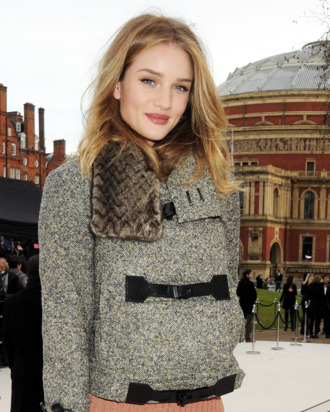 Rosie Huntington-Whiteley arrives at the Burberry Autumn Winter 2012 Womenswear Show during London Fashion Week at Kensington Gardens on February 20, 2012 in London, England.