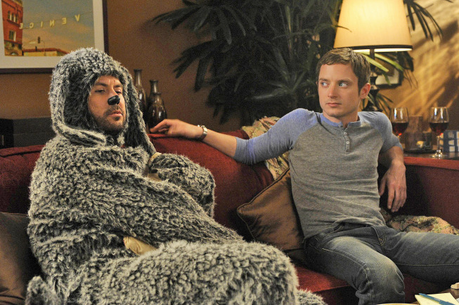 """WILFRED: L-R: Jason Gann and Elijah Wood in the WILFRED episode """"Conscience"""" (Airs July 28, 10:00 pm e/p) on FX. CR: Ray Mickshaw / FX."""