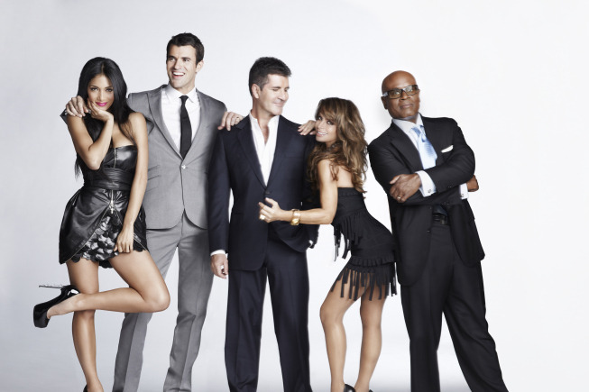 THE X FACTOR: THE X FACTOR, hosted by Steve Jones and featuring judges Simon Cowell, Paula Abdul, L.A. Reid and Nicole Scherzinger,  will award the next superstar solo artist or breakout musical group with a $5 million recording contract with Syco/Sony Music. THE X FACTOR will air on FOX. Pictured L-R: Nicole Sherzinger, Steve Jones, Simon Cowell, Paula Abdul and L.A. Reid. CR: Nino Munoz / FOX.