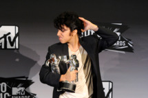 """LOS ANGELES, CA - AUGUST 28:  Singer Lady Gaga dressed as """"Jo Calderone"""", winner of Best Female Video Award and Best Video with a Message Award for """"Born This Way"""" poses in the press room during the 2011 MTV Video Music Awards at Nokia Theatre L.A. LIVE on August 28, 2011 in Los Angeles, California.  (Photo by Jason Merritt/Getty Images)"""