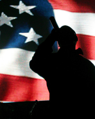 LAS VEGAS - DECEMBER 29: Rap artist Jay-Z is silhouetted against a video image of an American flag as he performs during a sold-out show at The Pearl concert theater at the Palms Casino Resort December 29, 2007 in Las Vegas, Nevada. (Photo by Ethan Miller/Getty Images)
