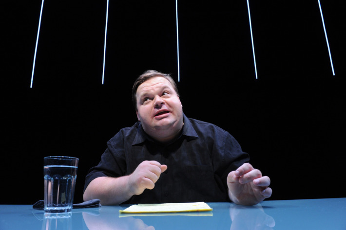 Mike Daisey in The Agony and The Ecstasy of Steve Jobs, created and performed by Mike Daisey and directed by Jean-Michele Gregory, running at The Public Theater. Photo credit: Stan Barouh
