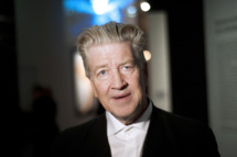 """US film director David Lynch poses at the French cinematheque (La Cinematheque Francaise) on October 13, 2010, in Paris during a visit of the """"Brune/Blonde"""" (Brunette/Blond) exhibition. The event runs until January 16, 2011.  AFP PHOTO POOL FRED DUFOUR (Photo credit should read FRED DUFOUR/AFP/Getty Images)"""