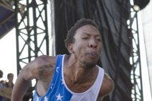 NEW ORLEANS, LA - OCTOBER 30: Rapper-producer Left Brain of the alternative hip-hop collective Odd Future Wolf Gang Kill Them All Future, shouts obscenities to a female photographer in the photo-pit right after hitting her during the 2011 Voodoo Experience at City Park on October 30, 2011 in New Orleans, Louisiana. (Photo by Skip Bolen/WireImage)