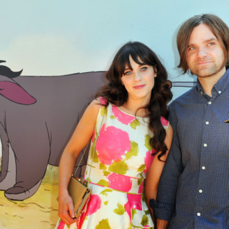 Actress/singer Zooey Deschanel and musician Ben Gibbard arrive at Walt Disney Pictures presents the premiere of