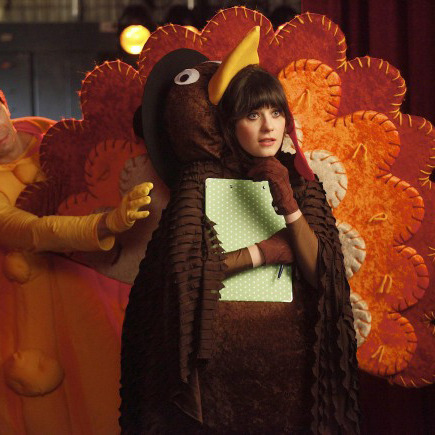 """NEW GIRL: Jess (Zooey Deschanel, R) and her crush, fellow teacher Paul (guest star Justin Long, L) watch their students perform in the school Thanksgiving festival in the """"Thanksgiving"""" episode of NEW GIRL airing Tuesday, Nov. 15 (9:01-9:31 PM ET/PT) on FOX. ©2011 Fox Broadcasting Co. Cr: Greg Gayne/FOX©2011 Fox Broadcasting Co. Cr: Greg Gayne/FOX"""