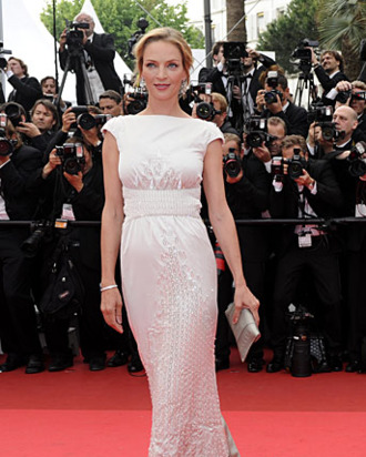 US actress Uma Thurman poses on the red carpet before the screening of