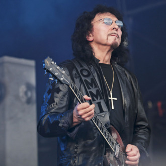 LONDON, UNITED KINGDOM - JULY 24: Tony Iommi performs for the last time ever with Heaven And Hell as a tribute to the late Ronnie James Dio at Day 1 of the High Voltage Festival at Victoria Park on July 24, 2010 in London, England. (Photo by Christie Goodwin/Getty Images) *** Local Caption *** Tony Iommi