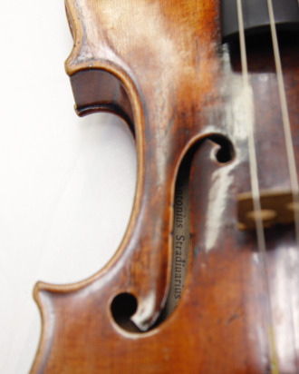A Stradivarius violin is pictured at the restoration and research laboratory of the Musee de la Musique in Paris, on December 3, 2009. For centuries, historians of music, instrument makers and chemists have been trying to decipher how Antonio Stradivari, working in the small Italian town of Cremona three centuries ago, was able to make violins whose acoustic qualities have never been surpassed. According to a French-German study published on December 4, 2009, on five violins stored at the Musee de la Musique (Cit? de la Musique), the varnish applied on the violins had red pigments added. AFP PHOTO PATRICK KOVARIK (Photo credit should read PATRICK KOVARIK/AFP/Getty Images)