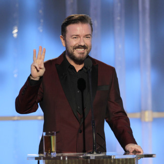 BEVERLY HILLS, CA - JANUARY 15: In this handout photo provided by NBC, host Ricky Gervais onstage during the 69th Annual Golden Globe Awards at the Beverly Hilton International Ballroom on January 15, 2012 in Beverly Hills, California. (Photo by Paul Drinkwater/NBC via Getty Images)