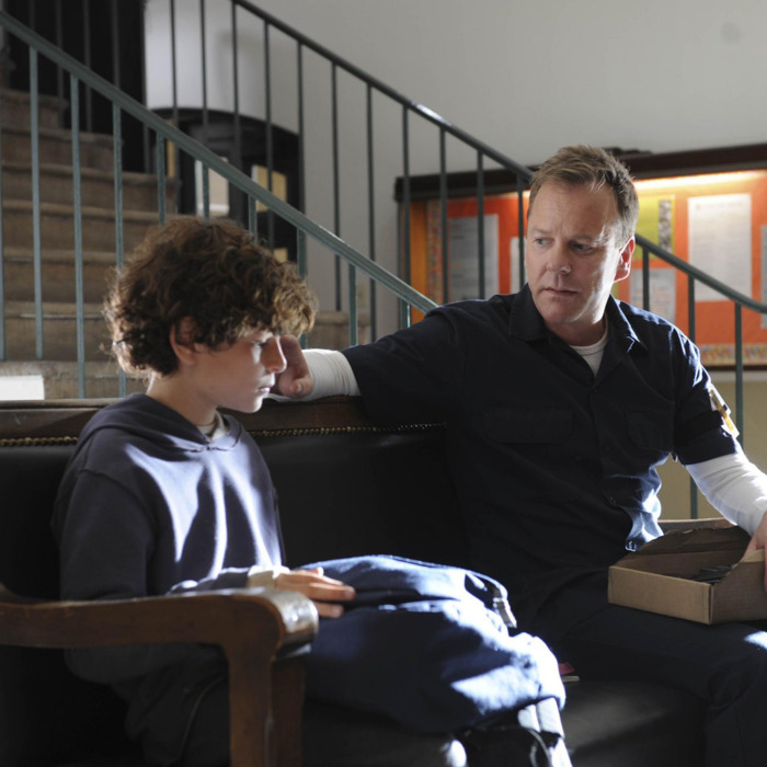Martin (Kiefer Sutherland, R) brings Jake (David Mazouz, L) to the state board and care facility in TOUCH.