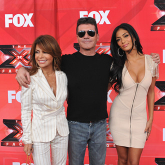LOS ANGELES, CA - DECEMBER 19: (L-R) Judges Paula Abdul, Simon Cowell and Nicole Scherzinger pose at The X Factor Press Conference at CBS Televison City on December 19, 2011 in Los Angeles, California. (Photo by Mark Davis/Getty Images)