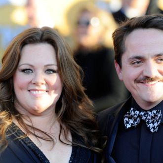 LOS ANGELES, CA - JANUARY 29: Actors Melissa McCarthy (L) and Ben Falcone arrive at the 18th Annual Screen Actors Guild Awards at The Shrine Auditorium on January 29, 2012 in Los Angeles, California. (Photo by Frazer Harrison/Getty Images)