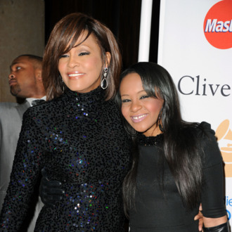 BEVERLY HILLS, CA - FEBRUARY 12: Singer Whitney Houston (L) and Bobbi Kristina Brown arrives at the 2011 Pre-GRAMMY Gala and Salute To Industry Icons Honoring David Geffen at Beverly Hilton on February 12, 2011 in Beverly Hills, California. (Photo by Jason Merritt/Getty Images) *** Local Caption *** Whitney Houston;Bobbi Kristina Brown